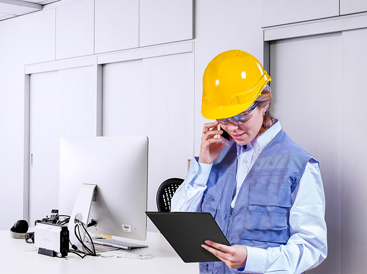 woman engineer with helmet and tablet
